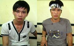Tân và Tuấn tại cơ quan điều tra.