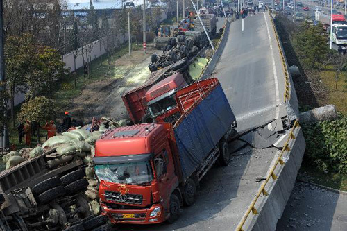 A truck is seen on a collapsed motorway viaduct in Shangyu of east China's Zhejiang Province, Feb. 21, 2011. The accident occurred early on Monday, with four trucks flipped over and three people injured