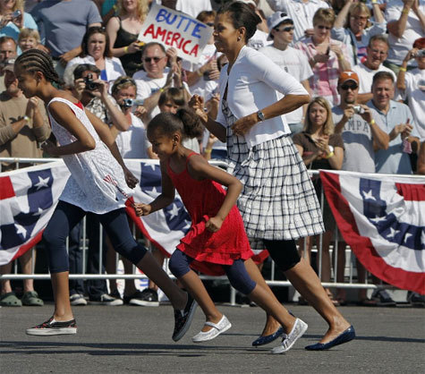 Running to watch a Fourth of July parade in Butte, Montana