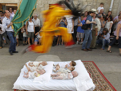 The origins of the tradition are unclear, but it's believed that the jumping devil takes away the evil from the newborn babies in the village.