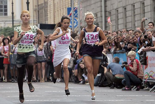 Russian girls run during a High heels race at Ostrovskogo square, in St.Petersburg, Russia. A hundred girls and women took part in the race to win 50 000 rubles