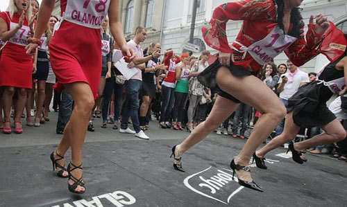 Russian girls run during a High heels race at Ostrovskogo square, in St.Petersburg