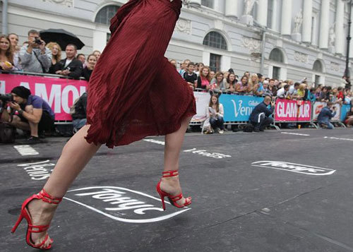 A Russian girl run during a High heels race at Ostrovskogo square, in St.Petersburg, Russia. About a hundred girls and women took part in the race to win 50 000 rubles