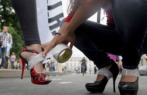 Russian girls prepare their feet and shoes during the high heels race sponsored by fashion magazine Glamour
