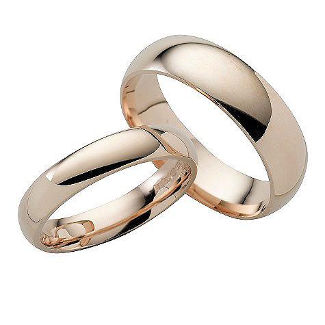 Nhẫn cưới thường trơn tròn, không đính kim cương. Ảnh: IM.