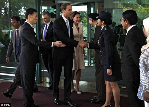 Prince William and Kate are welcomed by airport staff and crew as they arrive - half an hour late - in Singapore