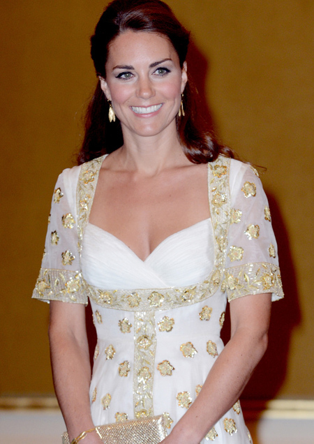 Glittering in gold, the Duchess of Cambridge dazzled in a stunning gown tonight as she attended a lavish dinner thrown by the rulers of Malaysia.