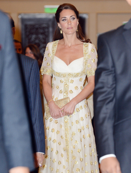 Kate's golden gown shimmers as she arrives at the lavish dinner