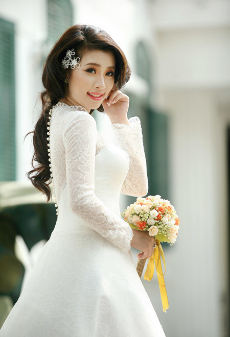 Ngọc Anh cho biết, cô thích chiếc váy này nhất vì nó che nhược điểm khá tốt, dù ban đầu cô muốn mặc váy đuôi cá hơn.