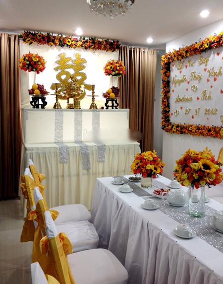 Nếu biết kết hợp khéo léo, màu vàng và cam sẽ đem đến cho không gian gia đình trong ngày cưới sự nổi bật, rực rỡ. Ảnh: Tường Huy.