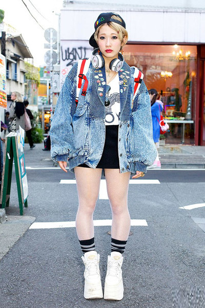 Here's a 19-year-old Harajuku girl whose cool short blonde hairstyle, oversized acid wash jacket, fishnet stockings & tall Buffalo platform sneakers definitely caught out eye. Her top is from Boy London too!