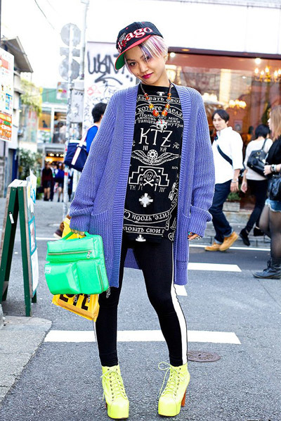 Here's a friendly girl named Maiko who we met in Harajuku. Maiko is wearing a KTZ top with H&M tights & Jeffrey Campbell ankle boots. Her bag is from the Japanese brand Porter.