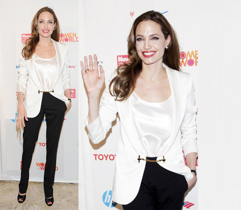 Angelina Jolie waves hello at the Women in the World Summit on Thursday (March 8) at New York Citys Lincoln Center. Wore Gucci