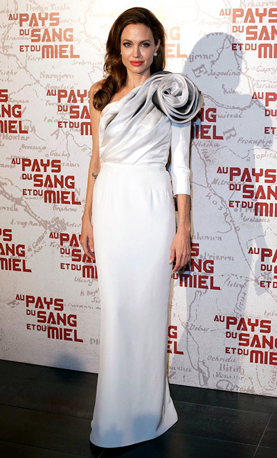 The Dress: An asymmetric white gown by Ralph & Russo with giant corsage detail. The Occasion: The French premiere of her film In The Land Of Blood And Honey in February 2012.