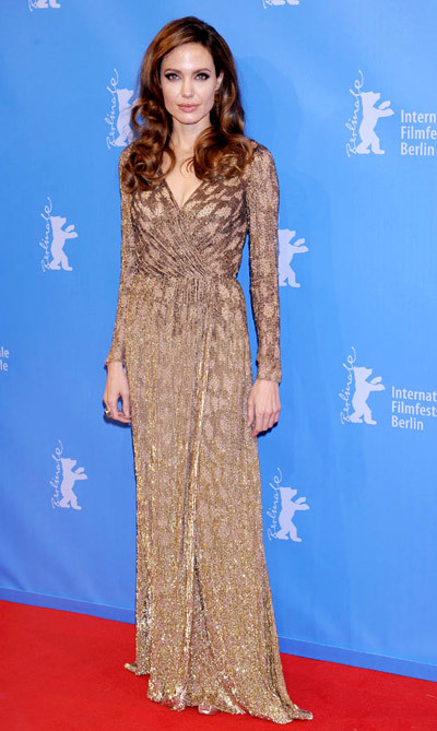 The Dress: Cross-front, long-sleeved Jenny Packham shot through with shimmering gold thread. The Occasion: In The Land Of Blood And Honeys Berlin premiere.