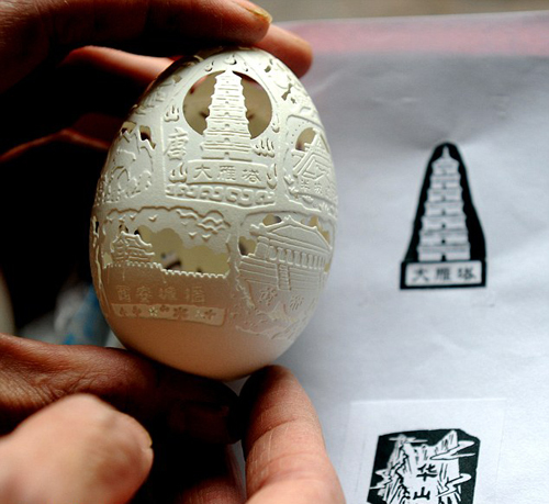 They must then gently but securely hold the egg shell in one hand, the rotary tool in the other and slowly carve away the design in an incredibly time-consuming and skillful process.