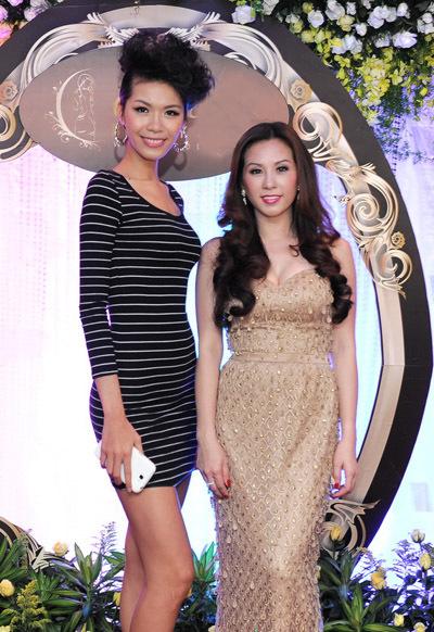 Siêu mẫu ấn tượng 2011 Minh Tú có chiều cao vượt trội so với Thu Hoài.