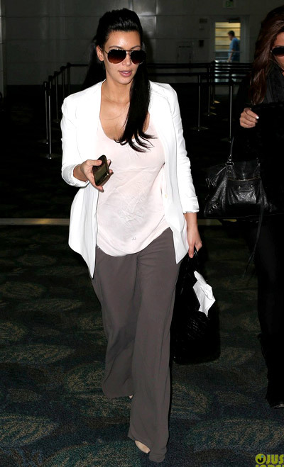 Kim Kardashian is casual chic while arriving on a flight with a gal pal on Sunday (January 6) in Miami, Fla.