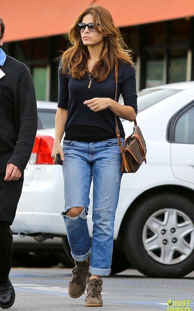 Eva Mendes dons ripped jeans while picking up some groceries with a gal pal at Gelson's Market on Sunday (December 30) in Los Feliz, Calif.