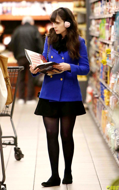 Zooey Deschanel dons cute ear muffs while doing some shopping at Gelson's market on Sunday (December 30) in Los Angeles.