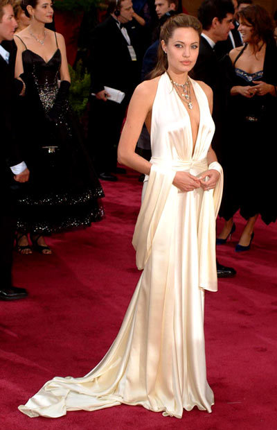 Angelina Jolie - 2004 Oscars The ice-white Marc Bouwer gown showed off all Angelina Jolie's assets at the 2004 Academy Awards.