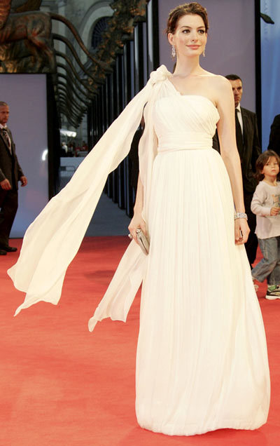 Having a fashion identity crisis? Call in the big guns: Rachel Zoe. It's no surprise that thanks to her, Hathaway started to step up her style, beginning with the Devil Wears Prada press tour, on which she wore this Grecian Alberta Ferretti gown, paired with flawless smoky eyes and a stately updo.