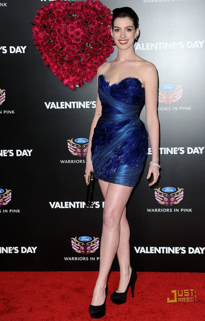 Hathaway channeled her inner vixen in a sapphire Marchesa feathered minidress, feather earrings by Garrard by Georgina Chapman, Roger Viver clutch and Casadei platform heels at the Valentine's Day premiere in Hollywood.
