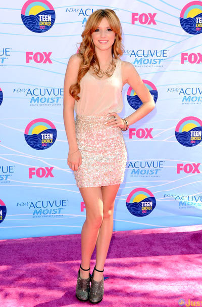Bella Thorne dazzles in a chic sparkly skirt at the 2012 Teen Choice Awards held at the Gibson Amphitheatre on Sunday (July 22) in Universal City, Calif. wearing Brian Atwood shoes and an All Saints skirt and blouse