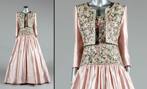 This Mughal-inspired pink silk gown, which was designed by Catherine Walker especially for Diana's state visit to India in February 1992, is set to fetch between 80,000-120,000 pounds. The inspiration for embroidery came from the lid of an Indian inlaid marquetry box discovered in a London market. It was during this trip that Princess Diana was famously photographed sitting alone at the Taj Mahal.