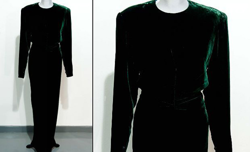 A Victor Edelstein evening gown worn by Britain's Princess Diana for private entertaining in 1985. The gown is expected to sell for between 20,000 - 30,000 GBP (30,000 - 45,000 USD). This dark green velvet dinner gown has what appears to be the print of a small hand on the skirt -- possibly that of a young prince, said Kerry Taylor Auctions.