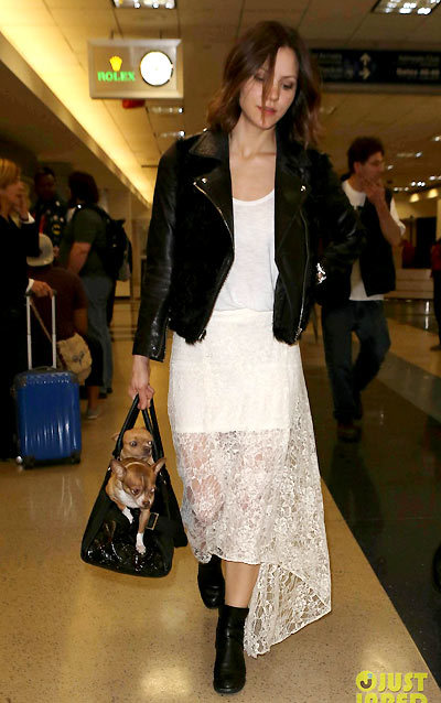 Katharine McPhee carries her two pet pooches while making her way through LAX Airport on Friday (March 15) in Los Angeles.