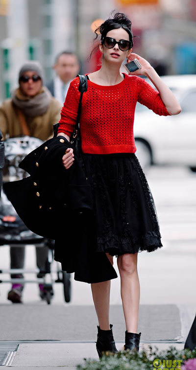 Krysten Ritter is red hot while checking text messages on her iPhone on Thursday (March 21) in New York City.