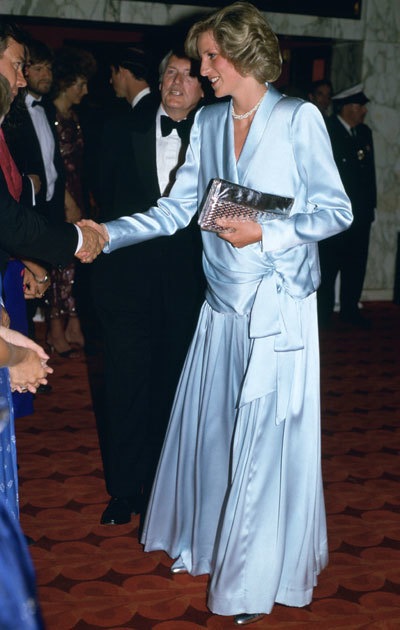 Diana, Princess Of Wales, Pregnant With Her Second Son, Prince Harry, Attending The Film Premiere Of 'Indiana Jones And The Temple of Doom' In Leicester Square Just Weeks Before His Birth. She is wearing a pale blue Catherine Walker gown