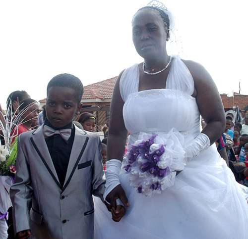 Eight-Year Old Sanele Masilela posing with his 61-year-old bride at their wedding ceremony. The marriage has caused shock-waves around the world