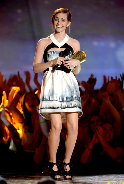 Emma Watson holds her Generation Award with pride at the 2013 MTV Movie Awards held at Sony Pictures Studios on Sunday (April 14) in Los Angeles. wearing a Maxime Simoens dress, Proenza Schouler shoes