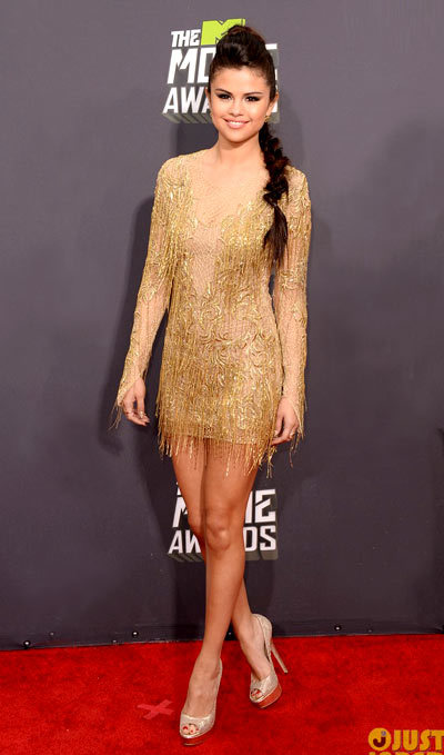 Selena Gomez is a golden girl on the red carpet at the 2013 MTV Movie Awards held at Sony Pictures Studios on Sunday (April 14) in Los Angeles.