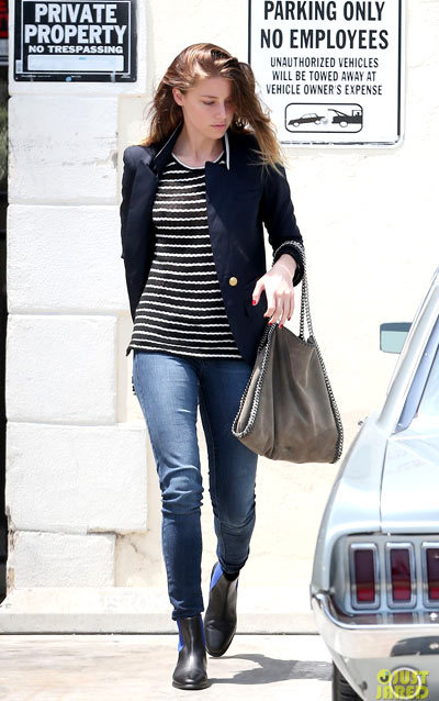Amber Heard showed her stripes while exiting a diagnostic clinic in Beverly Hills.
