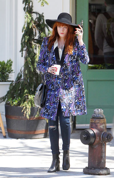 Florence Welch was spotted all bundled up while strolling around the Big Apple with a gal pal (May 1).