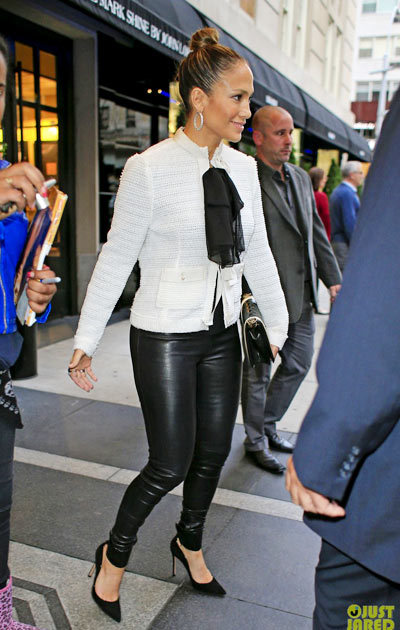 Jennifer Lopez holds hands with her boyfriend Casper Smart while heading for a showing of the Broadway play Pippin on Tuesday (May 7) in New York City.