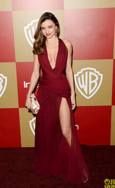 Miranda Kerr and Orlando Bloompose for pictures together as they arrive at the Warner Bros and InStyle Golden Globe Awards After Party held at the Oasis Courtyard at the Beverly Hilton Hotel on Sunday (January 13) in Beverly Hills, Calif. wearing a Zuhair Murad burgundy chiffon gown featuring a plunging neckline and high slit,
