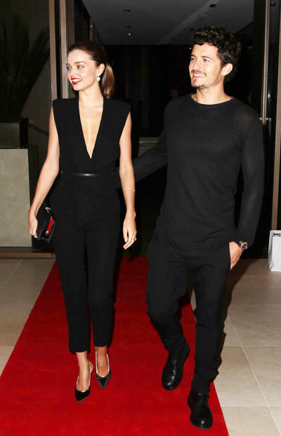 Miranda Kerr and husband Orlando Bloom pose together on the red carpet at the announcement of the Qantas and Emirates Partnership on Thursday (September 6) in Sydney, Australia. wearing a Carla Zampatti jumpsuit,