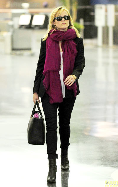 Reese Witherspoon shows off her new blond locks while arriving on a flight at JFK Airport with her husband Jim Toth on Monday (May 13) in New York City.