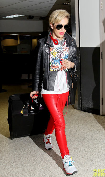 Rita Ora rocks red hot pants while arriving on a flight at LAX Airport on Saturday (May 4) in Los Angeles.