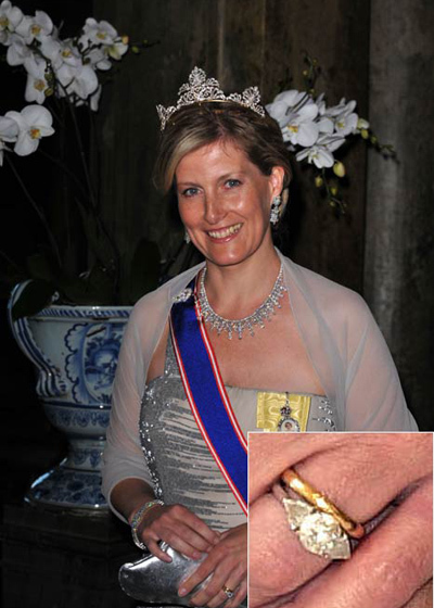 Sophie, Countess of Wessex, wore both rings on her wedding day: the two carat oval diamond engagement ring, flanked by two smaller heart-shaped gems, and her gold wedding band