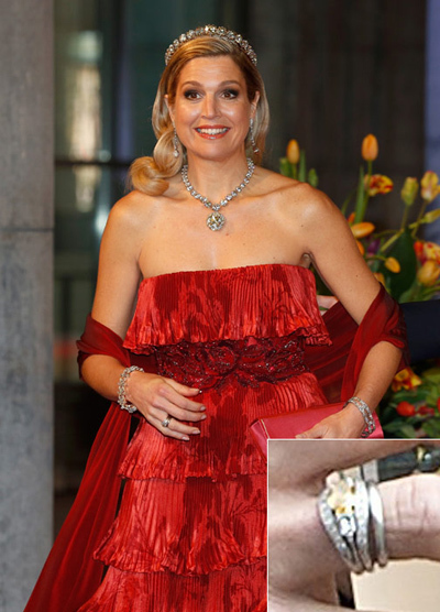 Queen Maxima, originally from Argentina, wears her unique orange, oval-shaped diamond engagement ring next to her wedding band.