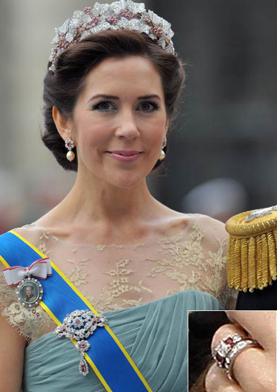 Princess Mary of Denmark usually wears her elaborate emerald cut diamond engagement ring and wedding band, but on the day kept all focus on the band.