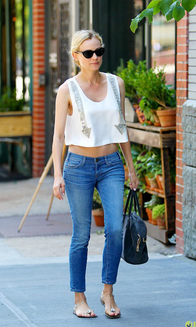 Diane Kruger shows off her midriff while taking a solo stroll on Saturday (June 15) in New York City.