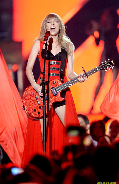 Taylor Swift rocks out during her performance of Red during the 2013 CMT Music Awards.