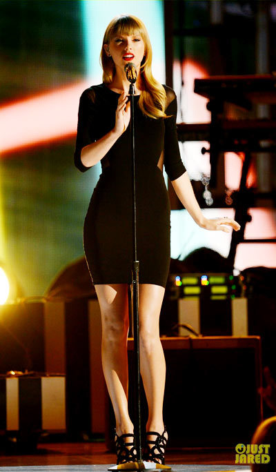 Taylor Swift dons a little black dress while performing onstage during Tim McGraw's Superstar Summer Night.