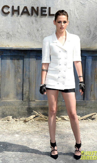 Kristen Stewart is a vision in white at the Chanel show as part of the 2013 Paris Fashion Week Haute-Couture Fall/Winter 2013-2014 presentation held at the Grand Palais on Tuesday (July 2) in Paris, France.